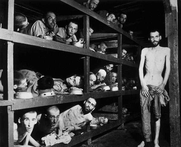 Victims of the Buchenwald concentration camp, liberated by the American troops of the 80th Division. Amongst them is Elie Wiesel (7th from the left on the middle bunk next to the vertical post) who went on to become an internationally famous writer, academic & winner of the Nobel Prize for Peace.   (Photo by H Miller/Getty Images)